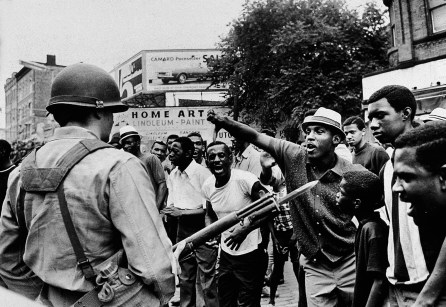 A National Guard member and protesters during the Newark race riots, July 1967