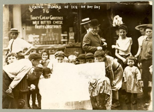 Children lick a block of ice on a hot summer day (Photo Bain News Service, 1912)