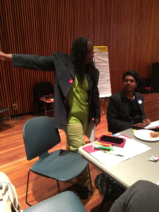 Harlem resident Michelle Holmes, left, works with scientist Prathap Ramamurthy, to brainstorm solutions to the challenges of urban heat at an Oct. 15 workshop.