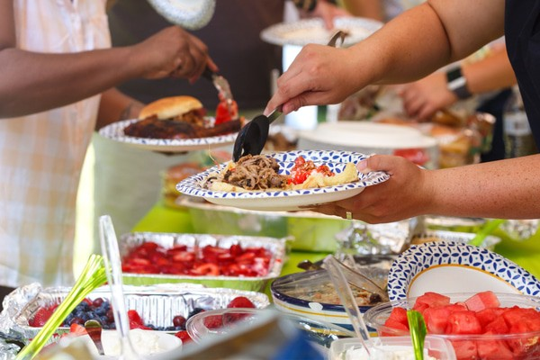 A potluck is a fun birthday event that'll allow everyone to chip in.