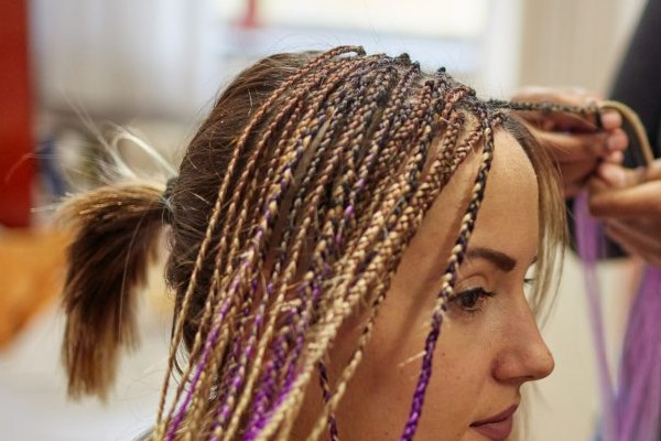 Try out colorful extensions on your hair.