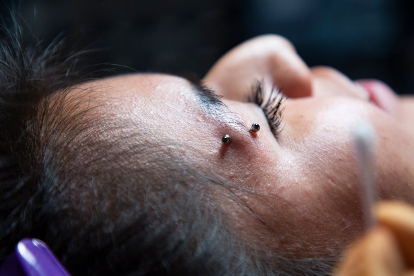 The pain associated with eyebrow piercing.