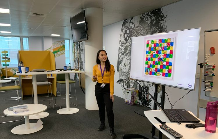 Giving a presentation about my third rotation - sharing the fact that my time in Platform Services was like a game of Snakes and Ladders.