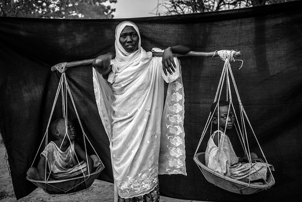 The most important object Dowla was able to bring with her is the wooden pole balanced over her shoulder, with which she carried her six children during the 10-day journey from Gabanit to South Sudan. At times, the children were too tired to walk, forcing her to carry two on either side.
