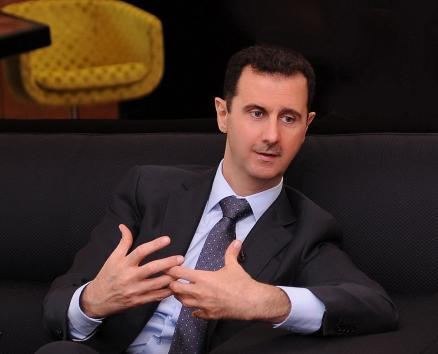 A handout photo distributed by Syrian News Agency (SANA) on July 3, 2012, shows Syria's President Bashar al-Assad during an interview with a Turkish newspaper in Damascus. UPI