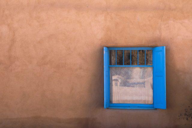 Blue Window on Orange House