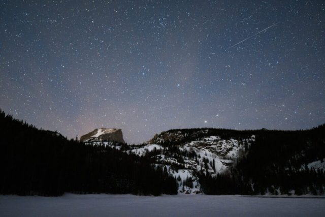 Because it gets dark early, winter can be a great time to capture celestial events like meteor showers over a landscape.