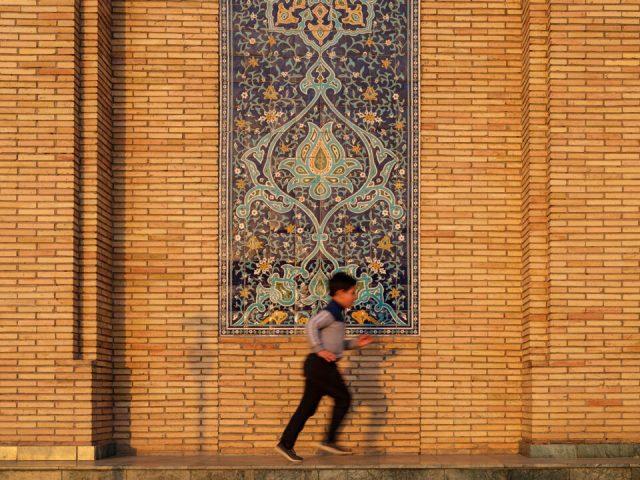Child playing in Khast Imam ensemble grounds