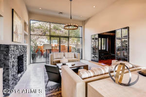 Views to both the Mountain Preserve and City Lights in this stunningly designed Living Room with limestone floors.