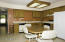 Raised panel honey oak cabinets, tile flooring, skylight, refrigerator offered with the property.