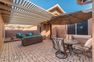 """Pergola covered courtyard with brick pavers set in 4"""" of concrete."""