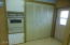 Kitchen with built in oven and pantry. Pantry area could be converted to hold washer/dryer