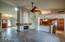Floor to ceiling fireplace separates great room from family room