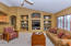 Vaulted ceiling, media/art niches w/upgrade glass shelves trimmed out in wood