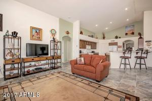 Spacious family room opening to the gourmet kitchen