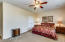 Spacious master bedroom with a large picturesque window, high ceilings, and en suite bathroom w/ HUGE walk-in closet