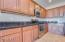 Stylish open kitchen with an abundance of storage space.