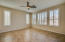 Spacious master bedroom with great views of beautiful backyard.