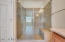 Incredible over sized walk in shower with glass door.