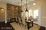 Dining Room with stone wall.