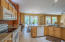 Overlooks Great Room, newer bisque color appliances. Upgraded maple cabinets.
