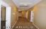 DOWN THIS HALLWAY IS THE GUEST BATH - 3 BEDROOMS AND AT THE VERY END IS THE SINGLE CAR GARAGE