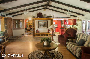 Real wood beams accentuate the eaves of this expansive great room. Any style would be at home here!