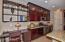 Customer Desk and Shelves off kitchen