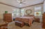 The master bedroom is steps from the kitchen and great room. The master has a ceiling fan, and nice windows add soft light. The master bedroom is carpeted.