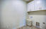 Spacious laundry room with cabinets