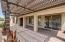 Extended pergola over backyard patio with professional misting system