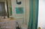 THIS IS A FULL BATHROOM WITH TUB & SHOWER LOCATED CONVENIENTLY NEAR THE GUEST ROOM.