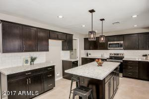 cabinets are solid stained espresso finish...the professional photos taken do not accurately depict the finish..it is much richer than the photos illustrate.
