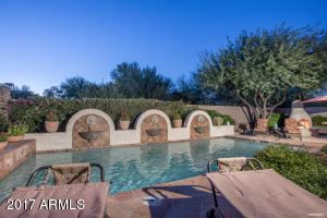 This backyard is made for entertaining! All tile patios, heated pool with fountains, built-in BBQ and gas fireplace.