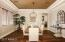 Formal Dining Room features a tray ceiling. Hardwood floors.