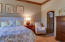 Master bedroom with large walk-in closet with custom organizer and pull-downs.