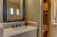 Dual sinks and vanities with custom mirrors. Private toilet room.
