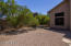 Your rear yard has great elbow room. Save the open space for play or add your preference of plants for a desert garden.