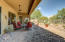 Mexican pavers flow from the covered patio into the yard, extending your outdoor entertaining space