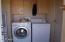 Laundry room with cabinets
