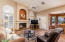 Cozy and Roomy Family room with wood burning fireplace.