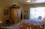Huge Master Bedroom with oversize sliding rear door exit to the Pool and backyard covered Patio !