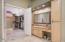 Vanity adjacent to closet wtih double doors