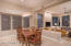 This dining area between the kitchen and the family room features a stunning light fixture
