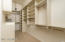 Custom classy closets with upper pull downs for additional storage