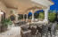 Outdoor Kitchen with BBQ and Dining Area