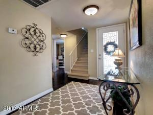 Enjoy the large entry way off of the Master bedroom that is downstairs. Beautiful glass front door.
