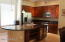 kitchen , granite counters, stainless steel appliances