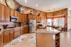 Gas cooktop, double ovens, island, quartz countertops, copper sink