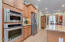 Kitchen with wall mount oven and convection microwave.